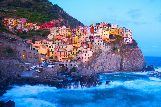 21650084 - manarola fisherman village in a dramatic wind storm. manarola is one of five famous villages of cinque terre (nationa park), suspended between sea and land on sheer cliffs upon the wild waves.