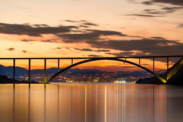 22189659 - bridge to krk island at sunset, croatia