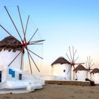 54419606 - scenic view of traditional greek windmills on mykonos island at sunrise, cyclades, greece
