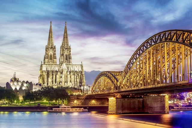 22508135 - illuminated dom in cologne with bridge and rhine at sunset