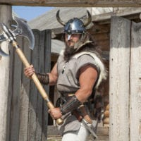 42292344 - strong real viking outside his home
